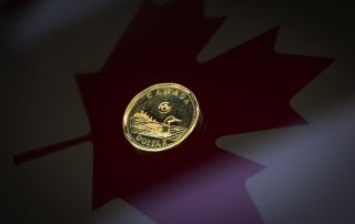 Canadian dollar weakens as oil prices shrug off output cut